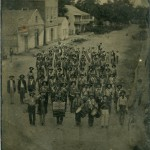 Company B, 3rd Akransas State Troops standing in a street.