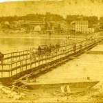 People crossing a pontoon bridge.