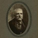 John Estes in suit.